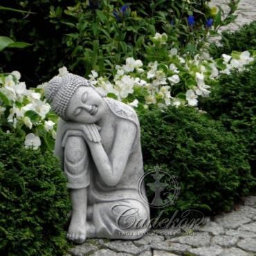 Budda oparty o kolano